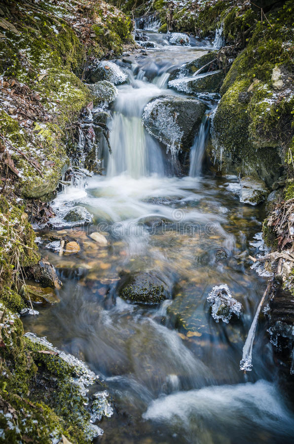 Small creek with a waterfall stock photography