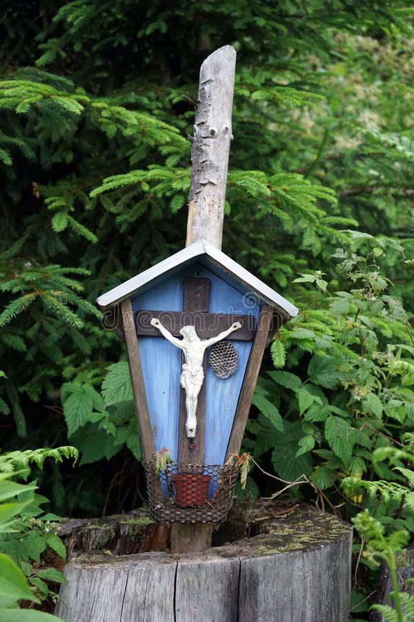 Small crucifix. In the dence forest in Austria stock photos