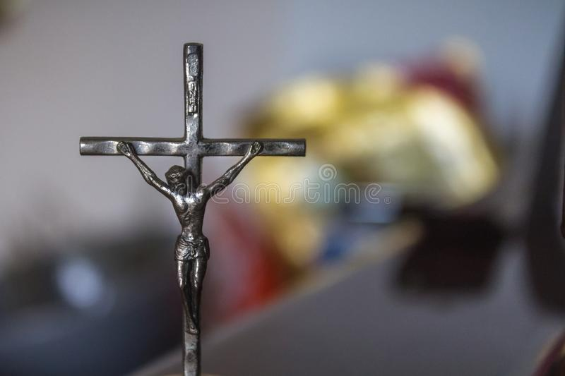 Small crucifix statue Christ on Cross. Metal figure royalty free stock image