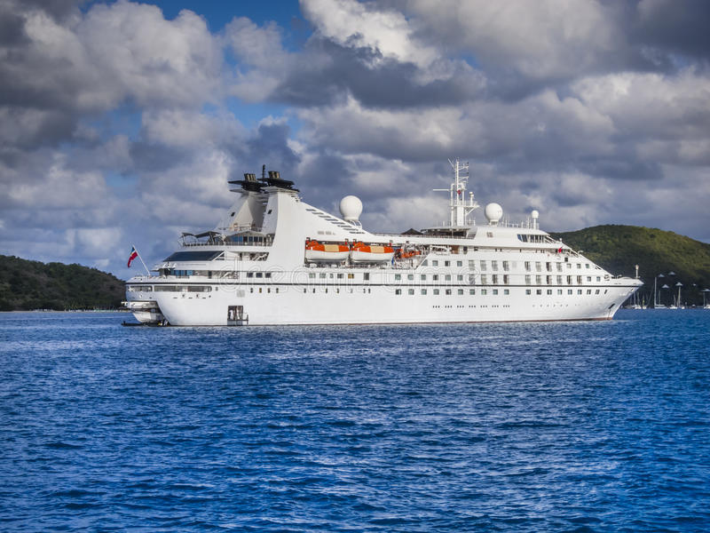 Small cruise ship. Off the BVI island of Virgin Gorda in Caribbean stock images