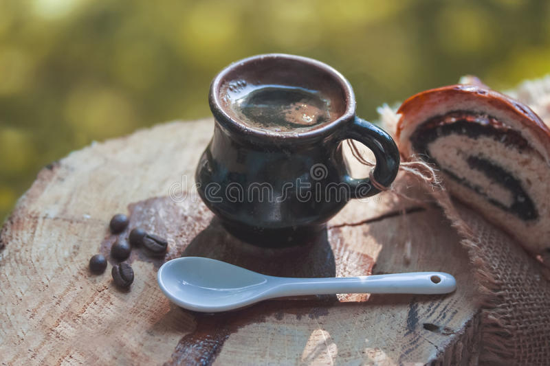 Small cup filled with black hot coffee early in the morning royalty free stock image