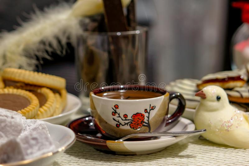 Small cup of hot turkish coffee with cookies on table stock images