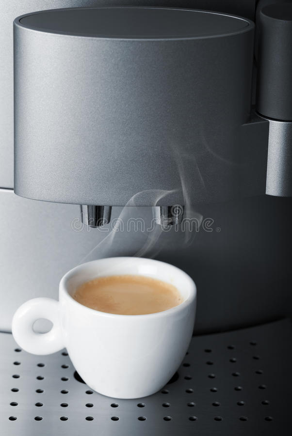 Free Small Cup Of Hot Espresso In Automatic Coffee Machine Royalty Free Stock Photos - 41995098