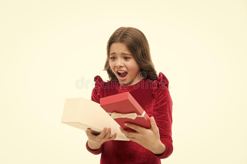Small cute girl received holiday gift. What is inside. Worst toys and christmas gifts for kids. Kid little girl elegant royalty free stock image