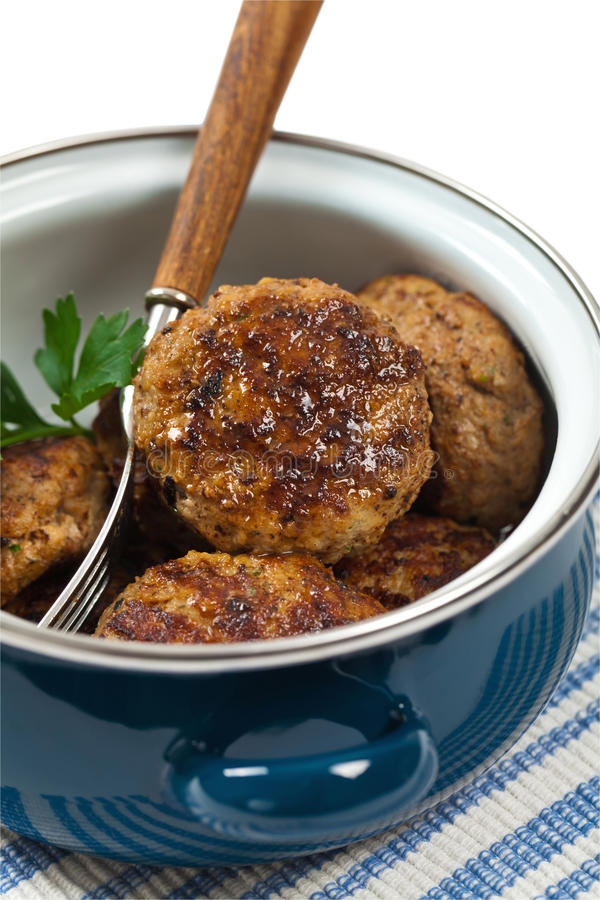 Small Cutlets or Sausage Patties. Small Meat Cutlets or Sausage Patties isolated on white background. Selective focus royalty free stock images