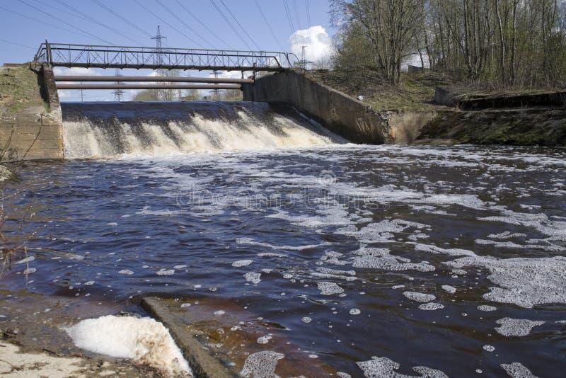 Small dam. Old small dam with metal bridge royalty free stock photo