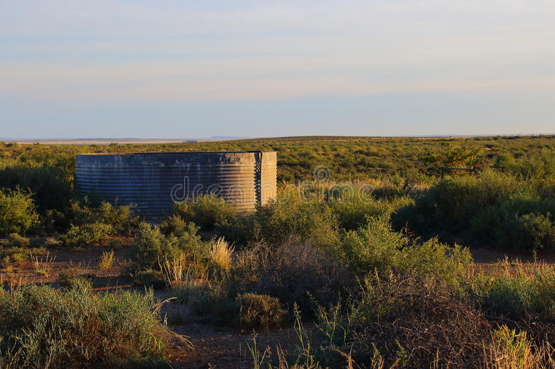 A small dam in the Karoo. A small farm dam in the sparse vegetation of the Great Karoo natural region in the Northern Cape of South Africa stock photo