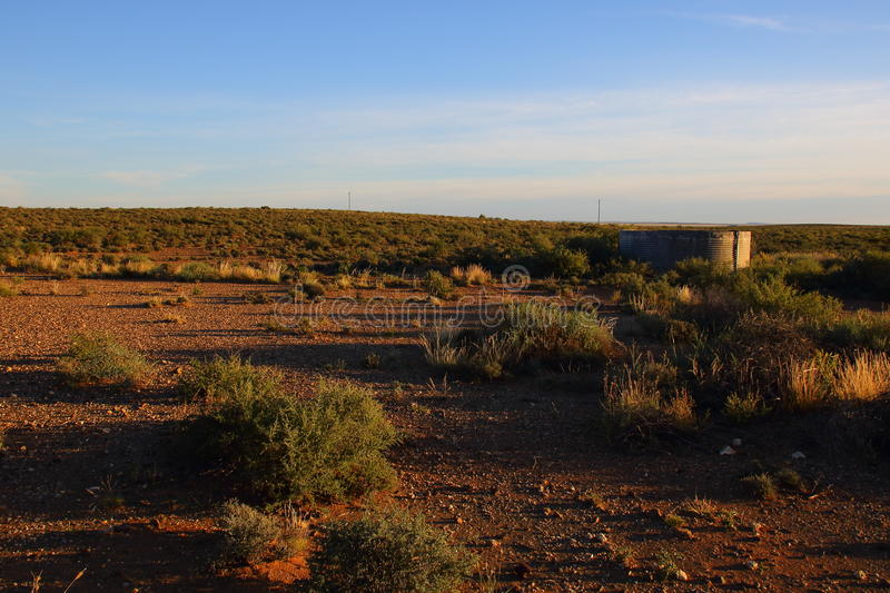 A small dam in the Karoo. A small farm dam in the sparse vegetation of the Great Karoo natural region in the Northern Cape of South Africa stock photography