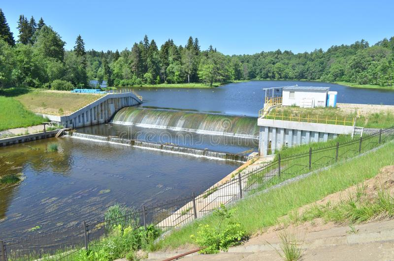 The small dam on a river. Is surrounded by forest royalty free stock photos