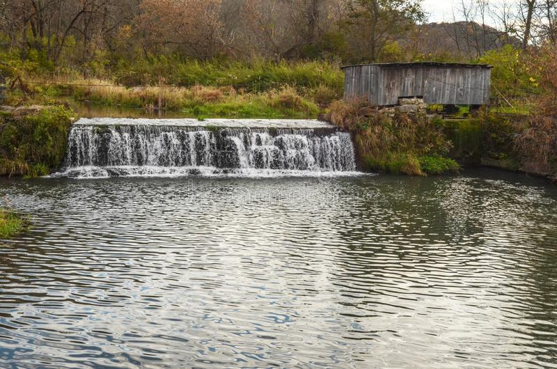 A Small Dam on the Stream Near Hyde`s Mill. A view of the small dam at Hyde`s Mill near Ridgeway, Wisconsin stock photos