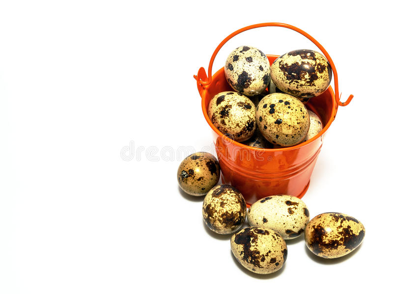 Small decorative buckets filled quail eggs. Small decorative buckets filled quail eggs close up royalty free stock photography