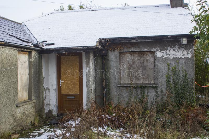 A small detached bungalow in ruins in Bangor County Down that has been unoccupied and abandoned for many years stock image