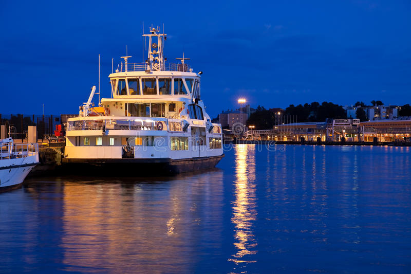 Small docked tourist ship. In evening royalty free stock images
