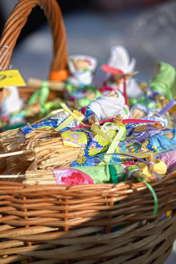 Small dolls from straw in a basket at a fair stock photo