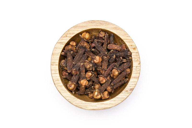 Small dried cloves spice isolated on white royalty free stock images
