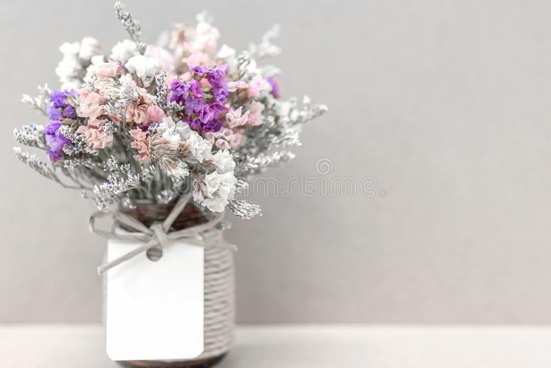 Small dried colorful flower on a vase with couple lover stock image