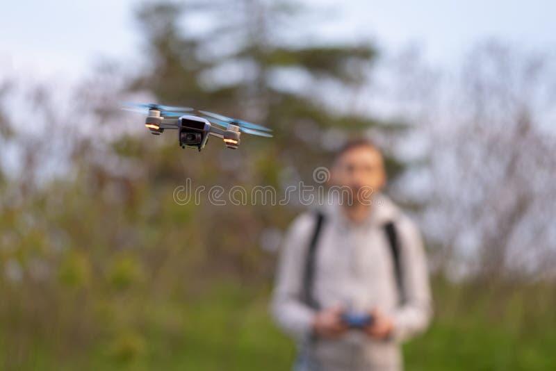 Young man navigates small drone. stock photos