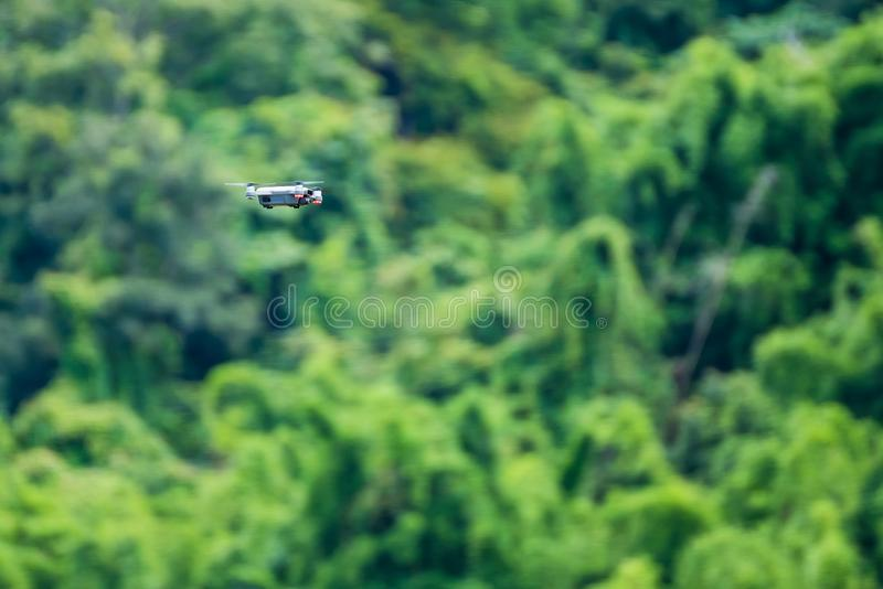 Small drones flying in the sky, Natural background. Closeup, wild, environment, forest, aerial, agriculture, air, aircraft, aviation, beautiful, camera royalty free stock images