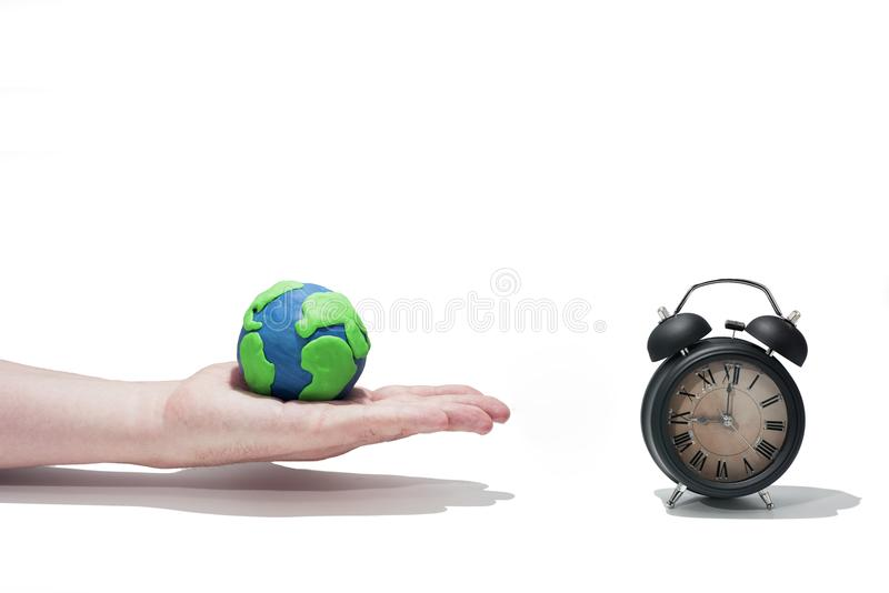 Small Earth model with human hands. Abstract composition of peace stock photos