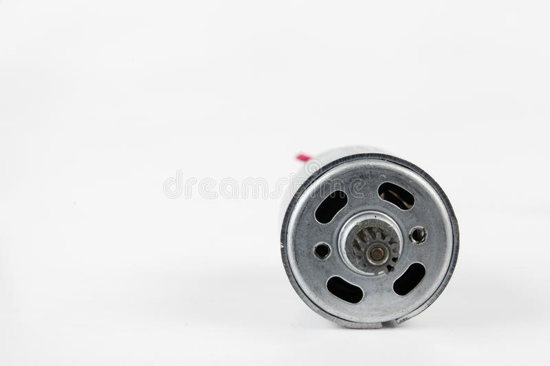 Small electric motor for household appliances. Electric drive po. Wered by low voltage. White background royalty free stock photos