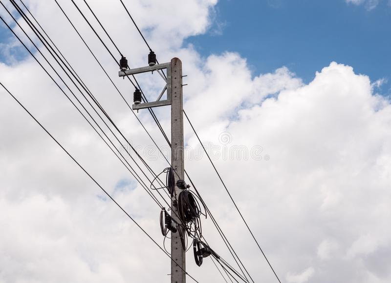 Small electric pole with the telephone cable. Small electric pole with the telephone cable under the clear blue sky royalty free stock images