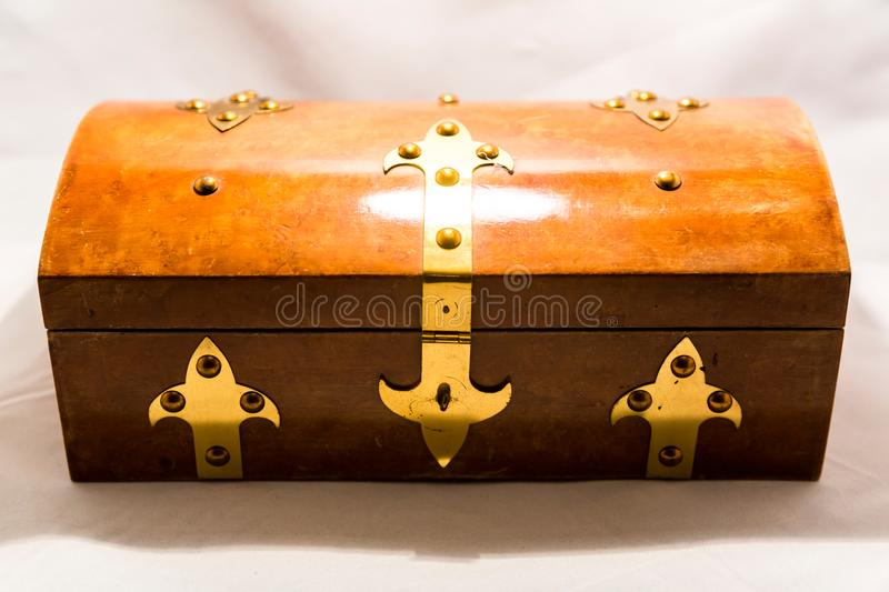 Small casket for valuables. Small elegant retro casket for storing valuables and jewelry royalty free stock photography