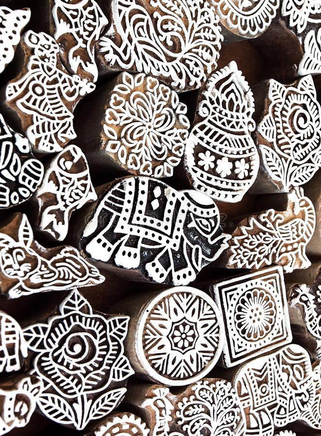 Small elephant and other symbols and patterns on wooden mold blocks for traditional printing textile. Design in India stock photos