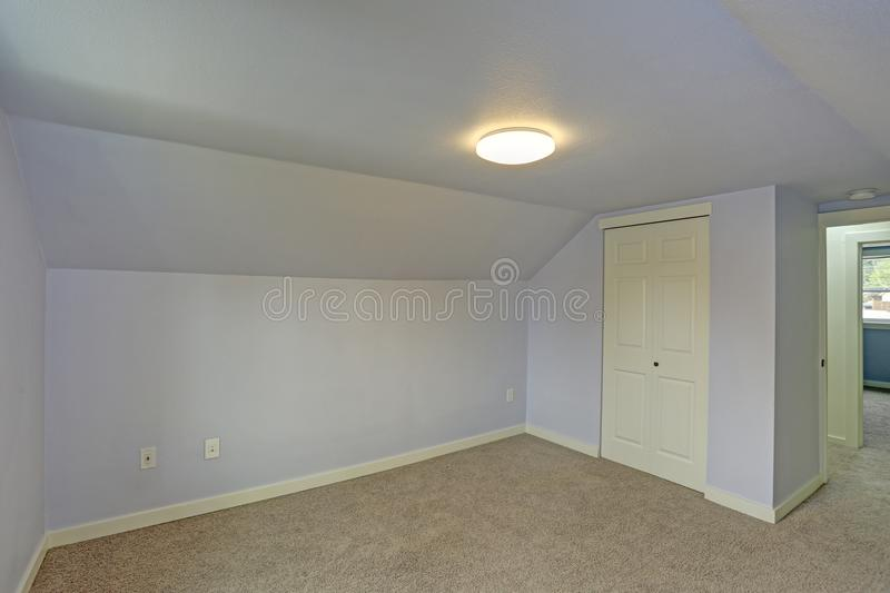 Small empty blue bedroom accented with vaulted ceiling stock photos