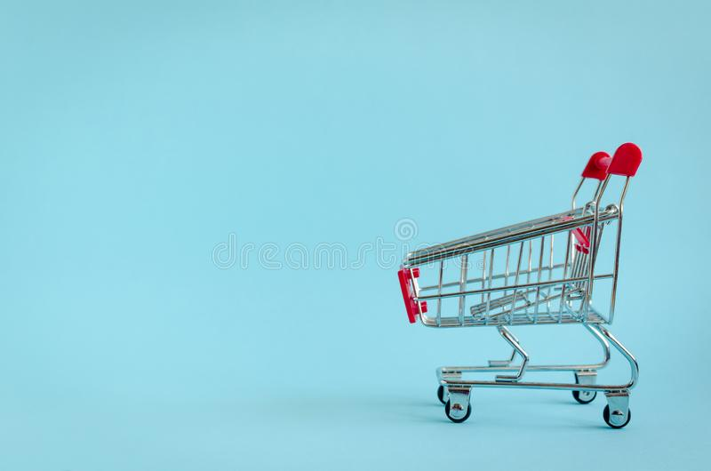 Small empty shopping cart royalty free stock photos