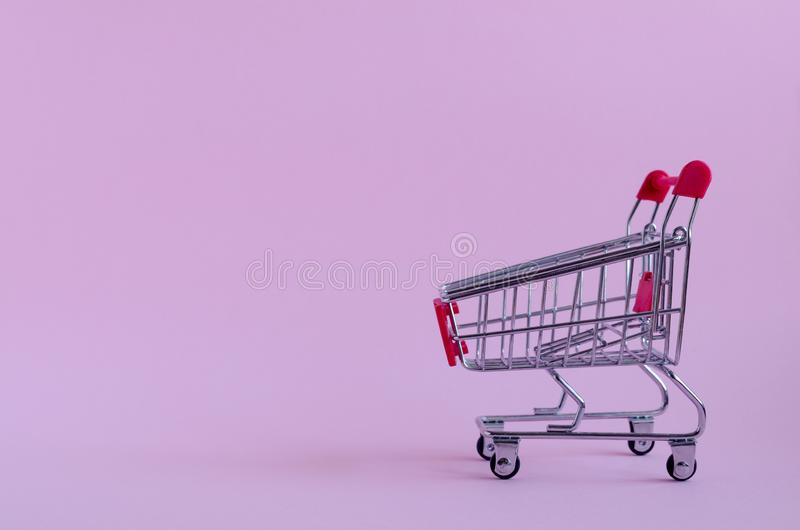 Small empty shopping cart royalty free stock photography