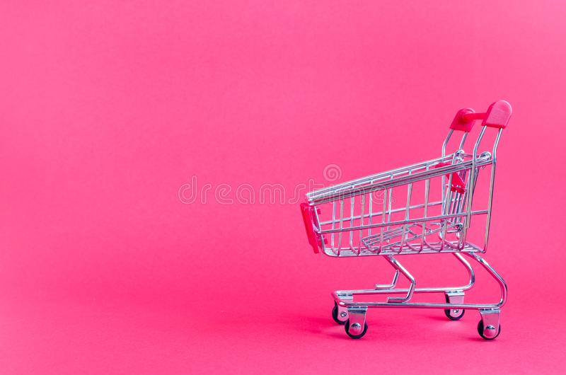Small empty shopping cart royalty free stock image