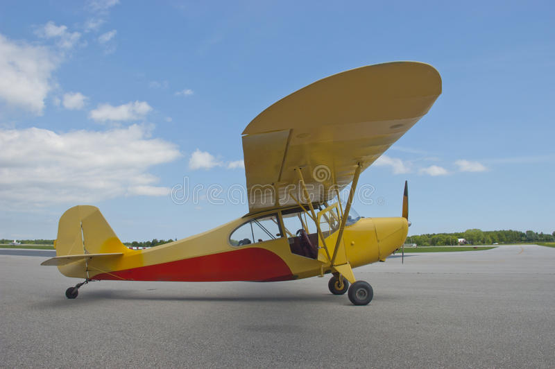 Small Engine Fixed Wing Aircraft Airplane Closeup. Small fixed wing single engine aircraft sitting on the runway in preparation for takeoff. The airplane is a stock photos