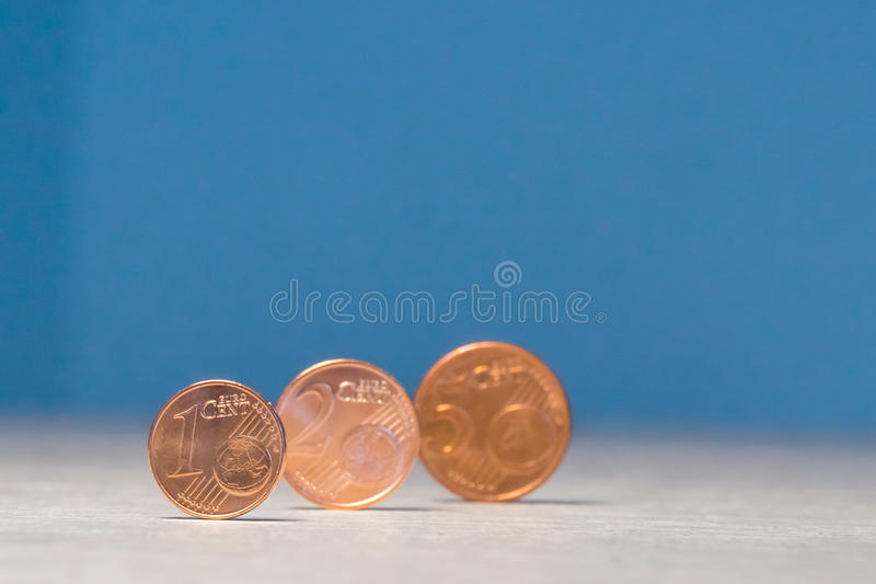 Small European cents. Stands by the edge royalty free stock photo