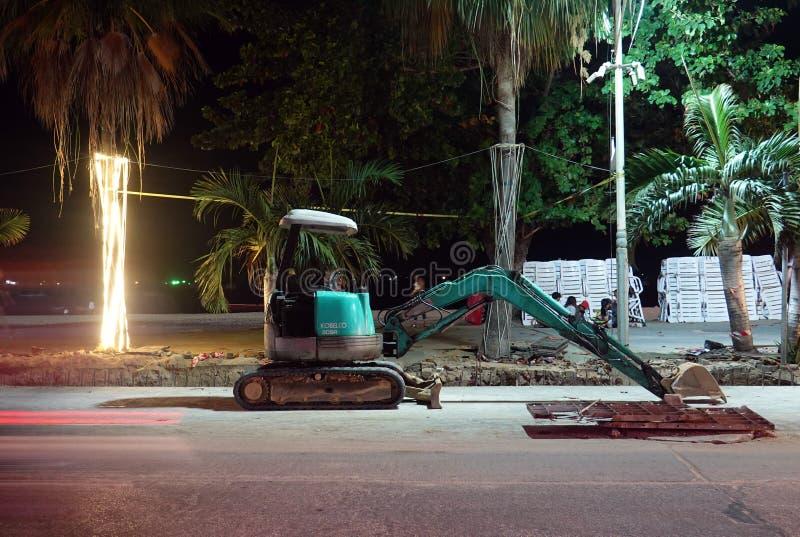 Small excavator on Beach Road at night. Pattaya, Thailand - December 23, 2019: Small excavator on Beach Road at night royalty free stock image