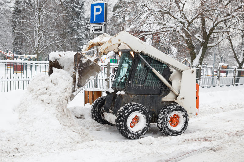 Download Small Excavator Bobcat Working On The Street Stock Photo - Image: 28148052
