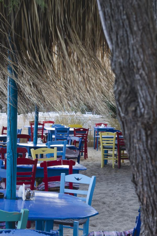 Small familily restaurant in Greece on a beach in the morning. S. Ummer lifestyle and travel concept royalty free stock images