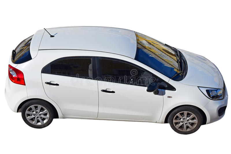 Small Family Hatchback Car With Street Reflections On Screen. Isolated With PNG File Attached. A white five door car showing reflections from the street royalty free stock photography