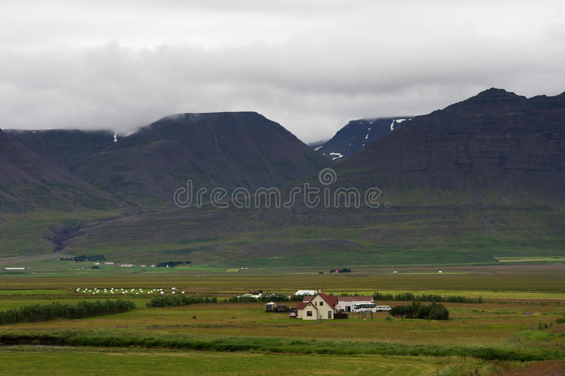 Small farm among green hills in Iceland royalty free stock photos