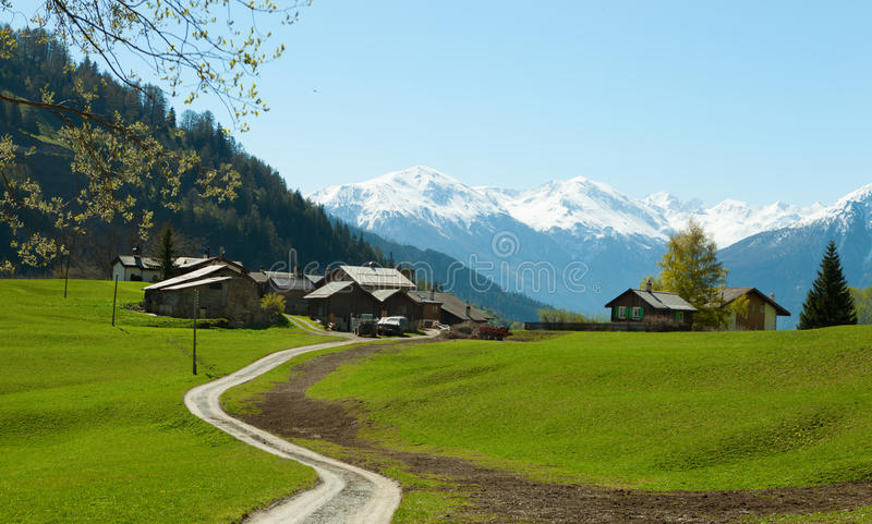 Small farm in Swiss alps stock images