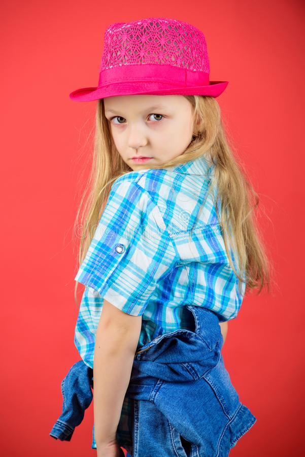 Small fashionista. Cool cutie fashionable outfit. Happy childhood. Kids fashion concept. Check out my fashion style. Fashion trend. Feeling awesome in this hat royalty free stock photography