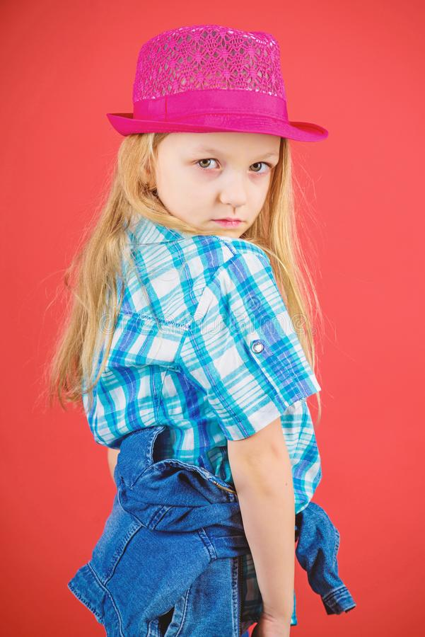 Small fashionista. Cool cutie fashionable outfit. Happy childhood. Kids fashion concept. Check out my fashion style. Fashion trend. Feeling awesome in this hat stock photos