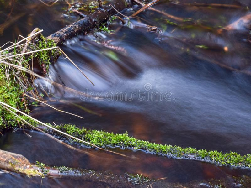Small and fast river, sunny spring day, slow exposure. Landscape with small and fast river, sunny spring day, slow exposure royalty free stock photo