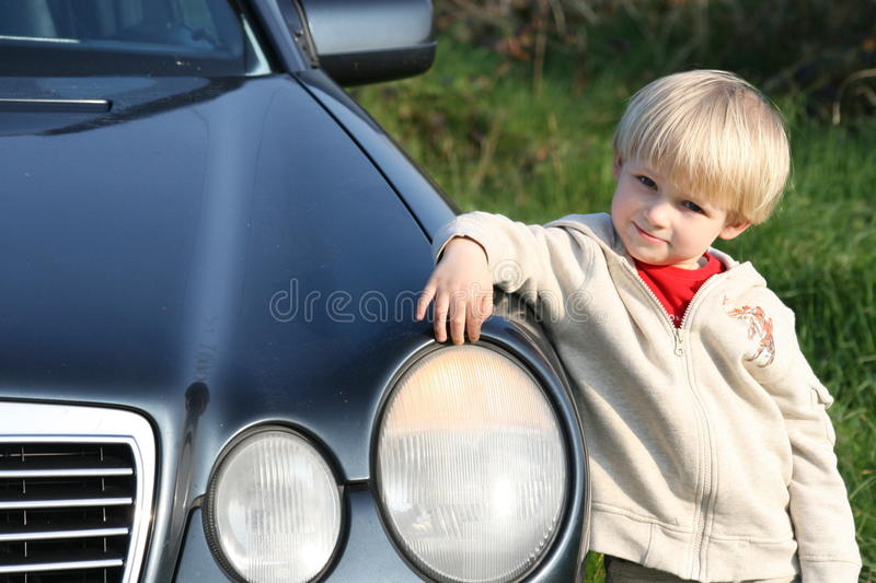 Download Small Fellow With Daddy's Car Stock Image - Image: 9385199