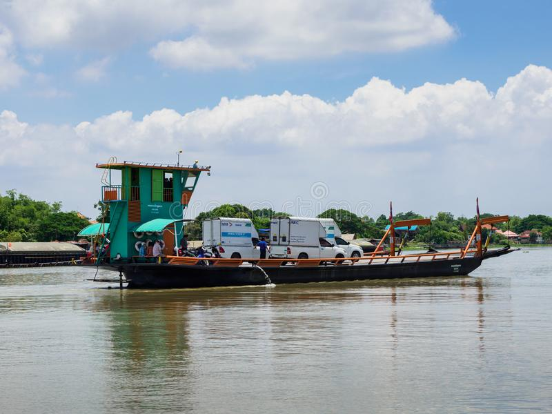 The small ferry carrying vehicles across Chao Phrata river in AyutthayaProvince. stock images