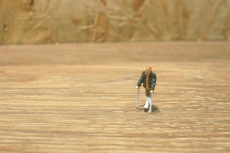 small of figure an with crutch isolated stock photos