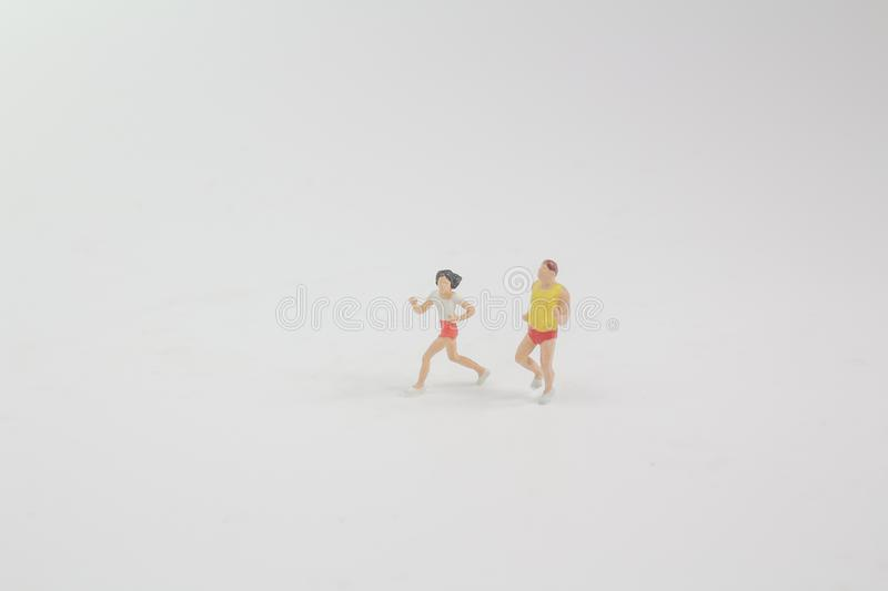 small figure run on machine in the gym stock photos