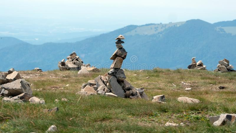 Small figures made of single stones stock image