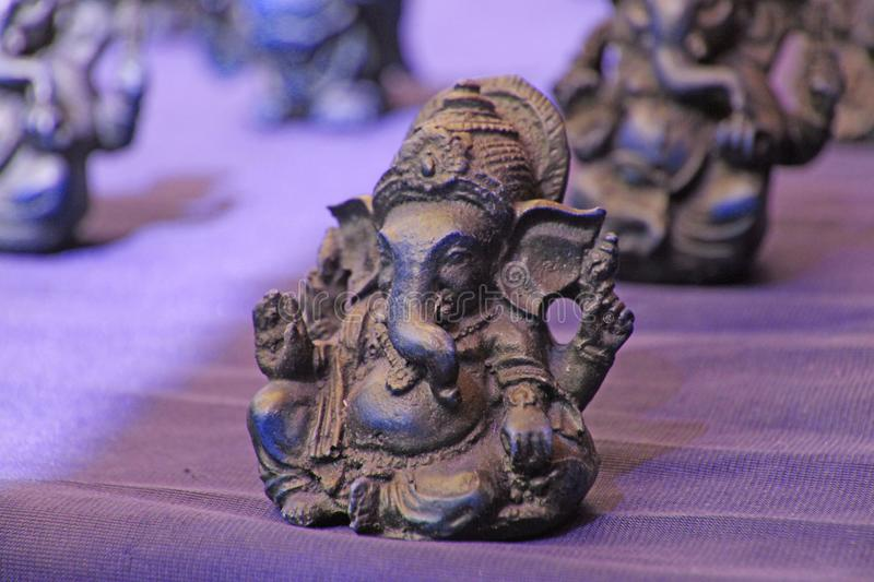 Small figurines of Buddha, Ganesha, Frog in the market of bazaars in India. Souvenir gift India.  stock image