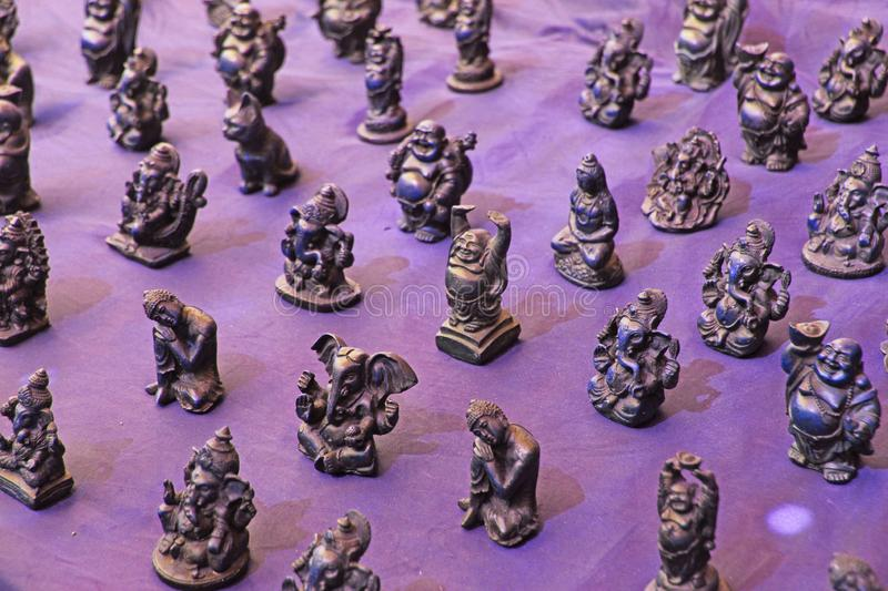 Small figurines of Buddha, Ganesha, Frog in the market of bazaars in India. Souvenir gift India.  stock photography