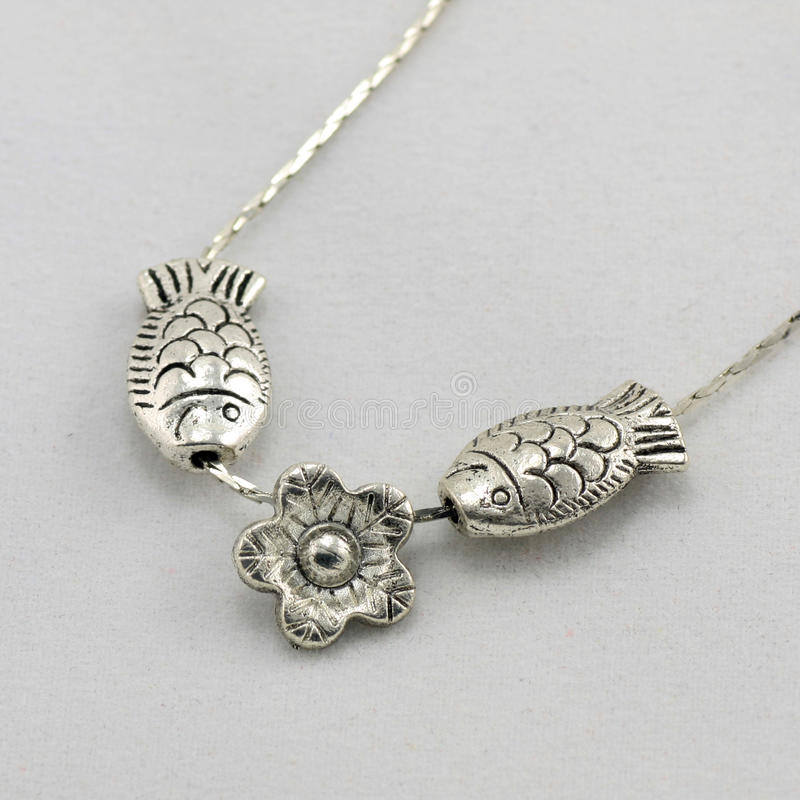 Small Fish-shaped Silver Necklace Royalty Free Stock Images